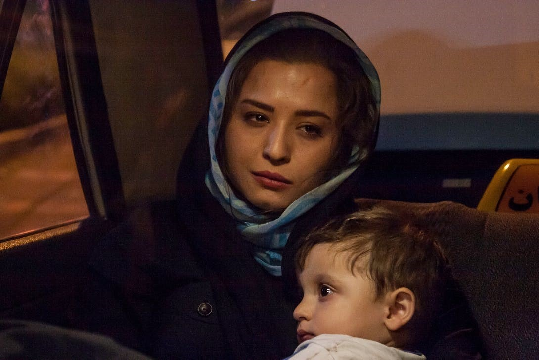 Woman sitting in car with child