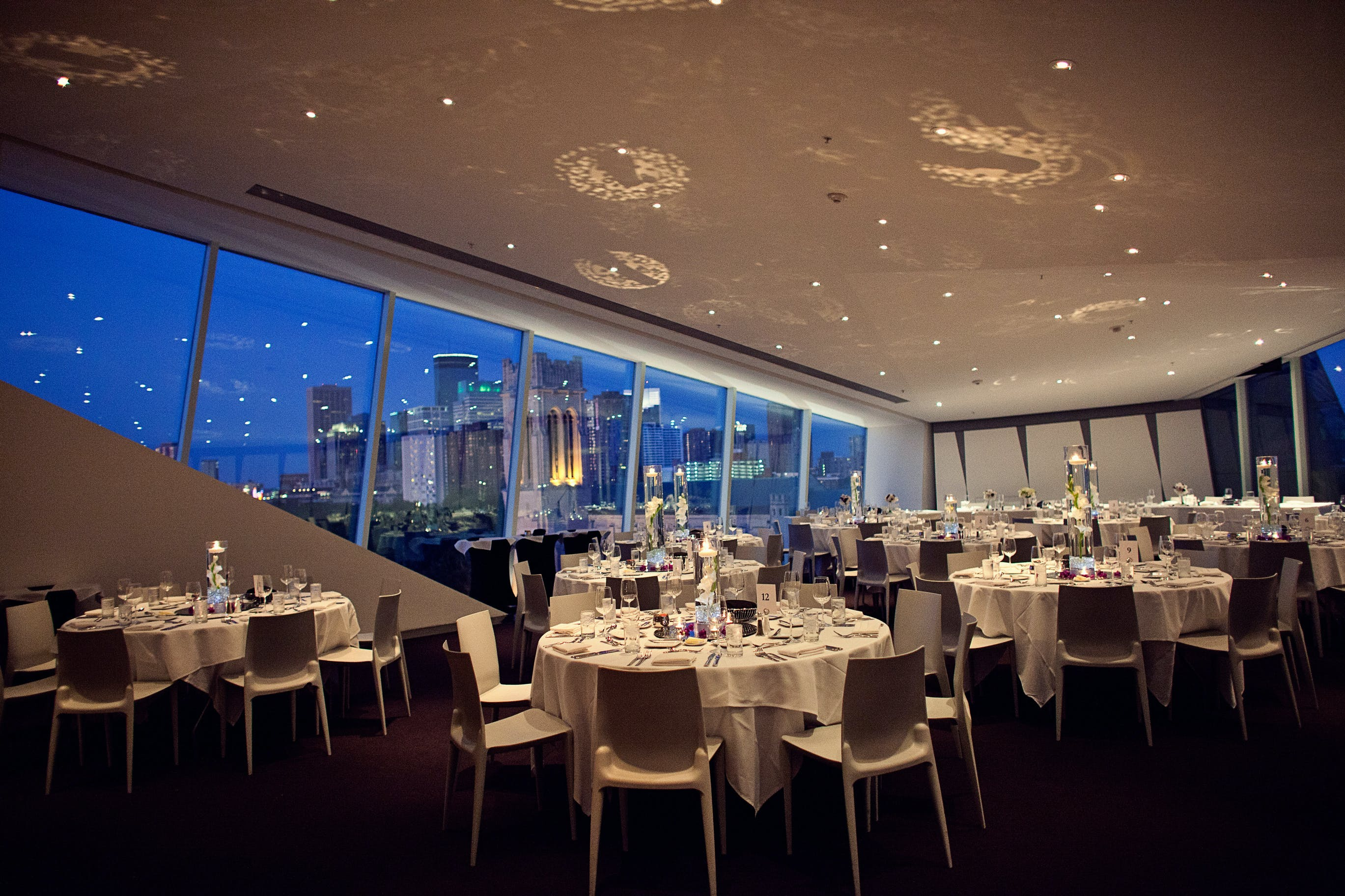 Skyline Room set for evening dinner with Downtown view at dusk