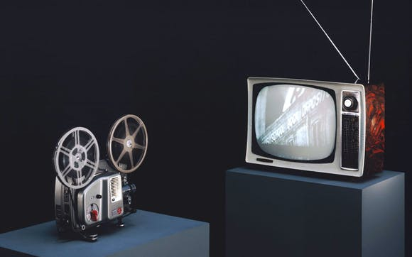 Film projector and older style television.