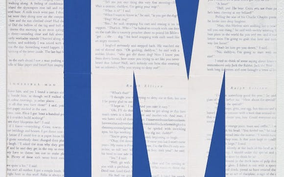 The letters I M over layed on a page of printed text.