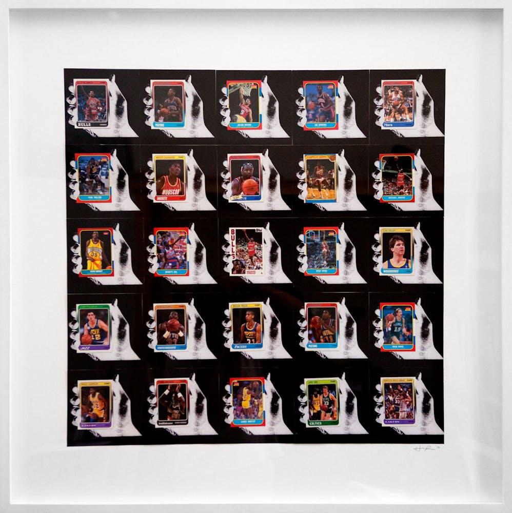 Framed artwork consisting of a grid of images of hands holding cassette tapes
