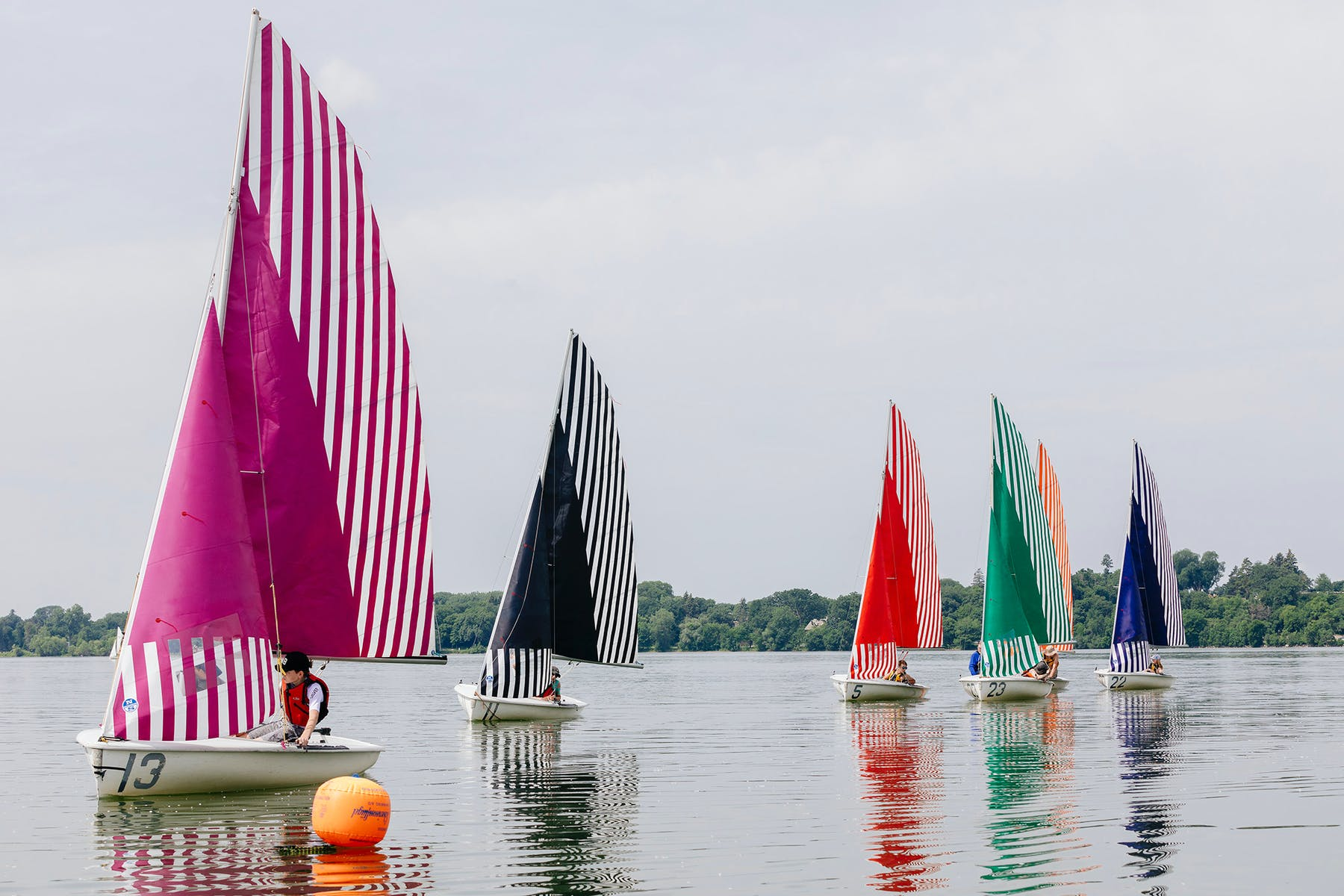 Daniel Buren's sails on sailboats in Lake Bde Maka Ska